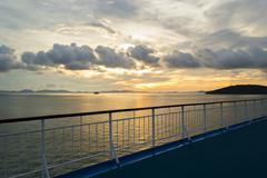 railing from cruise ship with sunset background - stock photo