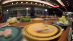 Sushi on conveyer belt Stock Footage