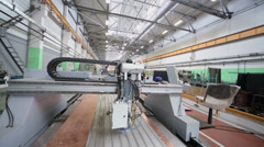 Automated machine tool and workers at workshop of factory Stock Footage
