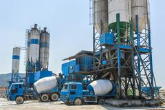 concrete mixing tower. concept of on-site construction facility - stock photo