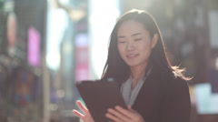 Asian woman in New York City Times Square talking cellphone - stock footage
