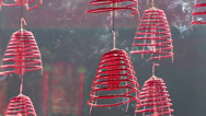 Stock Video Footage of Smoke from buring incense coils in Buddhist temple