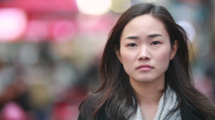 Asian woman in New York City Times Square sad face - stock footage