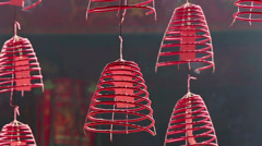 Burning incense coils in Buddhist temple Stock Footage