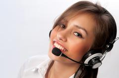 beautiful woman with headset smiling - stock photo