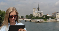 Ultra HD 4K Young Girl Businesswoman Use Portable Tablet Notre Dame Paris City Stock Footage