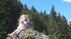 Child Looking in Binocular, Spyglass in Mountains Forest , Tourist Girl in Trip Stock Footage