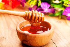 Honey dipper Stock Photos