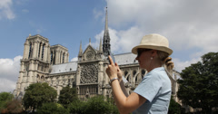Ultra HD 4K Happy Tourist Woman Take Taking Pictures Tablet Notre Dame Paris Day Stock Footage