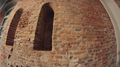 Old brick wall with two niches and a window Stock Footage