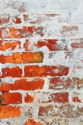 Stock Photo of old brick wall covered with cement and lime