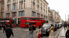 Black Cabs and Red Buses on Oxford Street, London - stock footage
