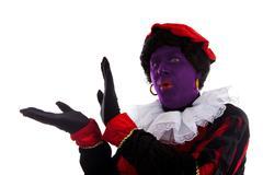 purple piet ( black pete) jest on typical dutch character - stock photo