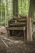 abandoned piano - stock photo