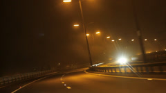 Car Driving Down Highway during Foggy Night - POV Point of View  - stock footage