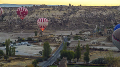 Motion timelapse of hot air balloons flying over valleys in Goreme, Cappadocia,  Stock Footage