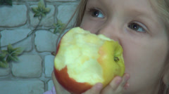 Child Eating Apple in Kitchen, Little Girl Has Fruit at Breakfast, Snack Time Stock Footage
