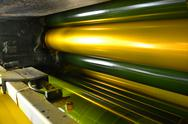 Stock Photo of print machine, yellow color drum, dramatic light