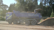 Stock Video Footage of blue truck dumping gravel at construction site