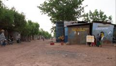 Timelapse in a little street in bamako, child playing Stock Footage