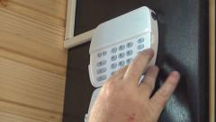 Worker Activating, Programming, Setting a Burglary Security System, Alarm Manual - stock footage