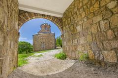 Colorful hdr ancient church view through the stone carved passage tunel, brig Stock Photos