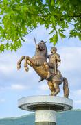 Amazing view of statue of alexander the great through the tree branches in do Stock Photos