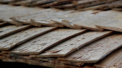 a really close footage of thecedar wooden shake shingle roof - stock footage