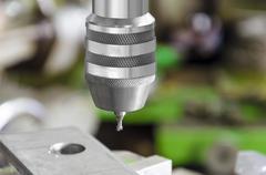 Drill machine closeup. macro shot from slight high angle Stock Photos
