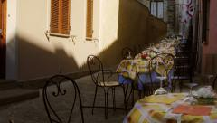 Table set of a restaurant outdoors Stock Footage