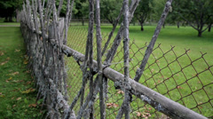 Lath and iron fenced farm land Stock Footage