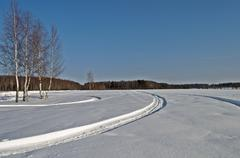 Snowmobile tracks in winter field Stock Photos
