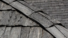 Close image of the red cedar wooden shingle shake roof of the log house Stock Footage