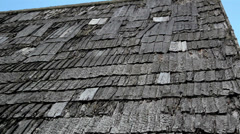 The cedar wooden shingle shake roof seems old and is somewhat damaged Stock Footage