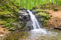 Waterfall and blue stream in the yellow forest macedonia Stock Photos