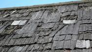 Stock Video Footage of the tattered cedar wooden shingle roof is about to cause some problems