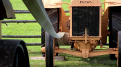 A big black rubber band is connected to the storehouse and the hammer mill Stock Footage