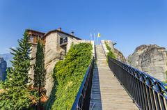 meteora monastery wide angle of bridge, meteora rousanou greece - stock photo