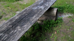 Up-close image of the park bench and growing grass movement Stock Footage