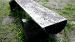 Three old grey wooden park bench in movement Stock Footage