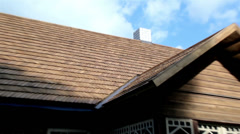 Roof of the cedar wooden shingle shake tar cabin log house Stock Footage
