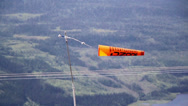 Stock Video Footage of orange banner tied to a pole while swaying mid-air