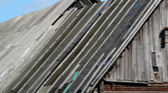 old black cedar wooden shingle shake roof and brown new roof - stock footage