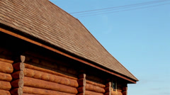 Up-close image of the brown colored cabin log house cedar log house roof Stock Footage