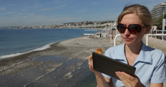 Ultra HD 4K Smiling Woman Using Digital Tablet Nice French Riviera Cote D'Azur Stock Footage