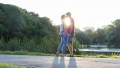 Young couple kissing at sunset, romantic love, sunshine kiss, click for HD - stock footage
