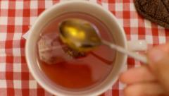 Tea cup from above teaspoon full of honey Stock Footage