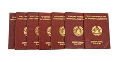 Tajikistan passports on white background Stock Photos