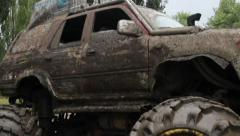 Huge big foot vehicle in dirt mud, mirrors wheels glass, click for HD Stock Footage