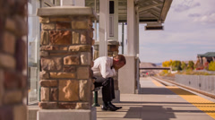 Train station man crying by himself - stock footage